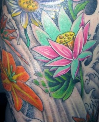 Bunch of flowers with lily tattoo