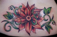 Red lily with greens tattoo