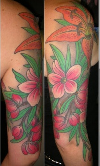 Lily flowers and blossom coloured tattoo