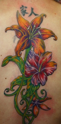 Tattoo of lilies with hieroglyphs