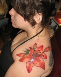 Tiger lily tattoo on shoulder