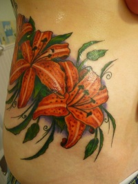 Tiger lily flowers detailed tattoo